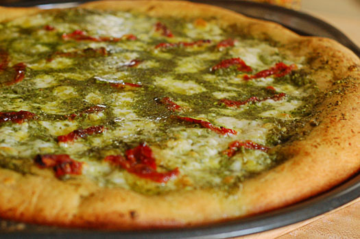 pesto pizza with sun dried tomatoes