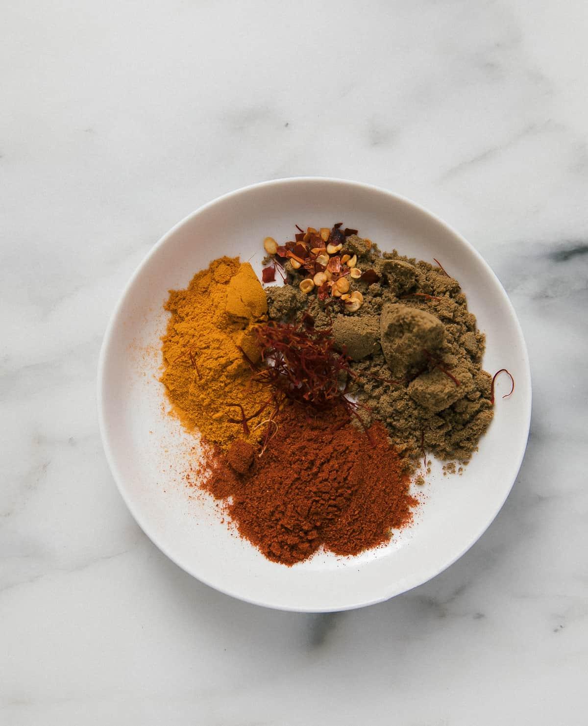 shot of spices: turmeric, paprika, cumin, saffron