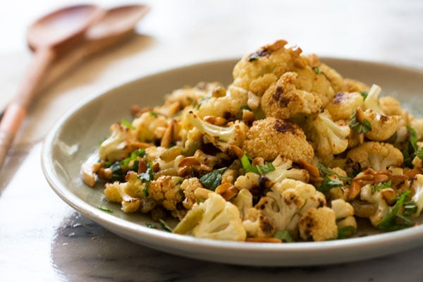 Roasted Cauliflower, Golden Raisin and Candied Almond Salad with Harissa Dressing