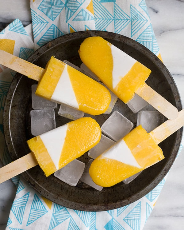 Mango Cardamom and Sweet Coconut Popsicles  www.acozykitchen.com
