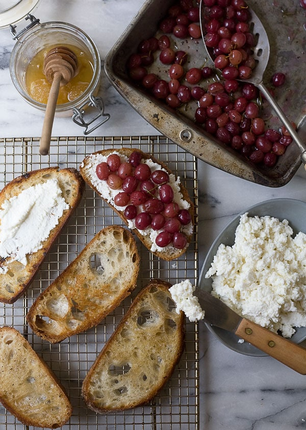 Roasted Grape Ricotta Crostinis with Rosemary and Pinenuts // www.acozykitchen.com