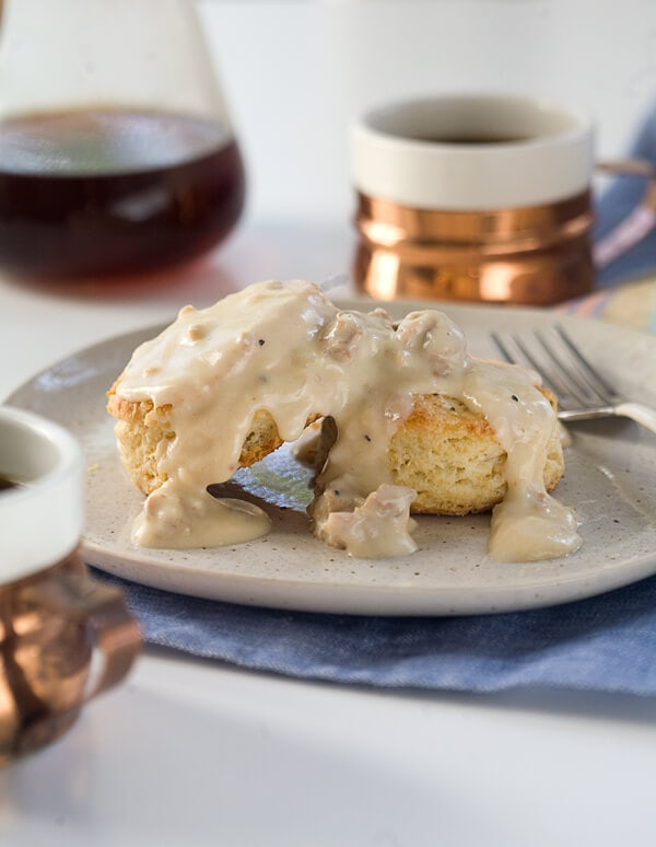 Spicy Sausage Country Gravy with Buttermilk Biscuits // www.acozykitchen.com