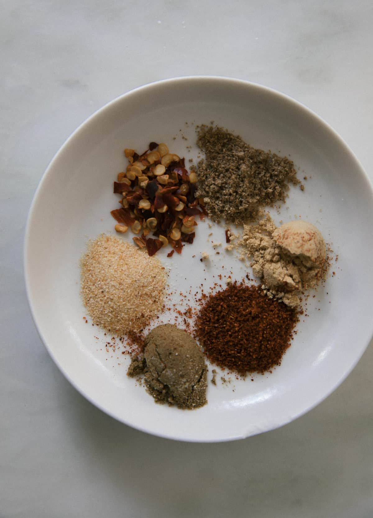 small plate with a variety of spices