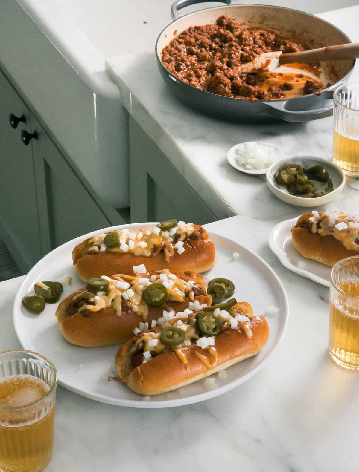 Chili Cheese Dogs Side Angle with Pot and Plate