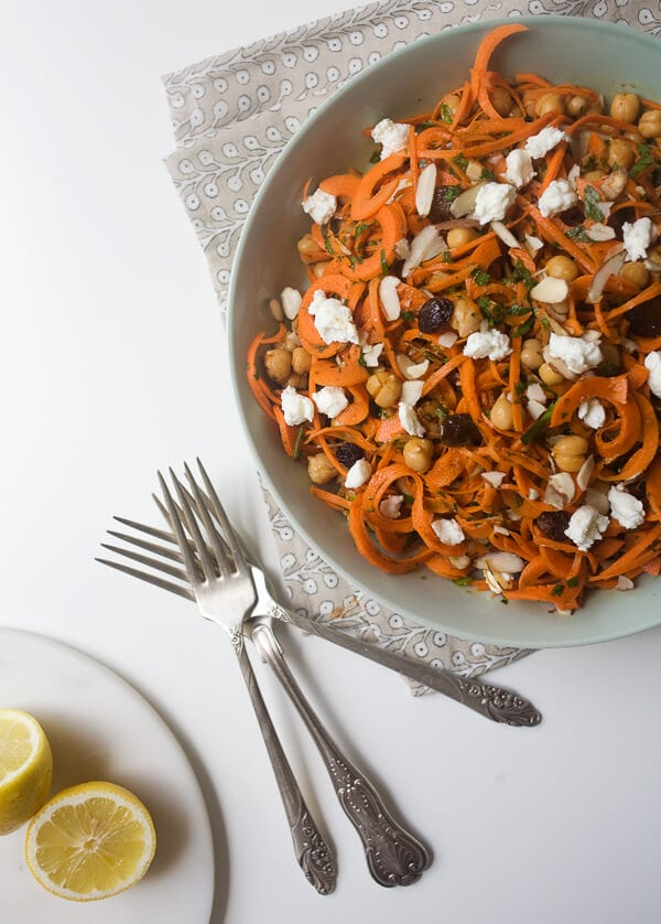 Moroccan Carrot Noodle Salad with Golden Raisins, Harissa and Goat Cheese