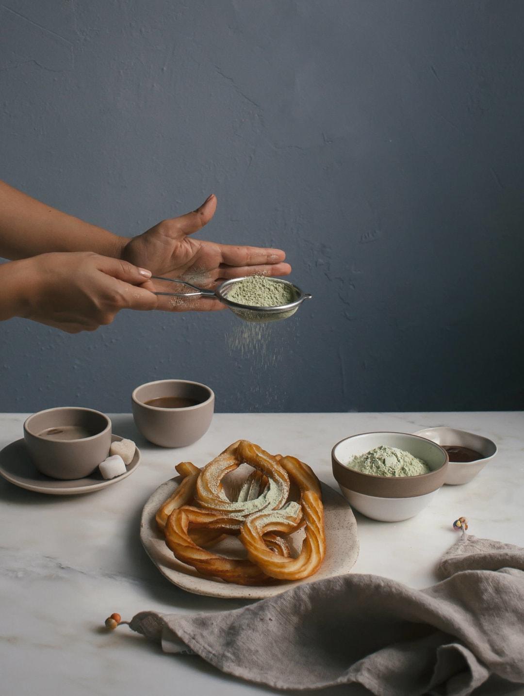 Matcha sugar dusted churros a cozy kitchen