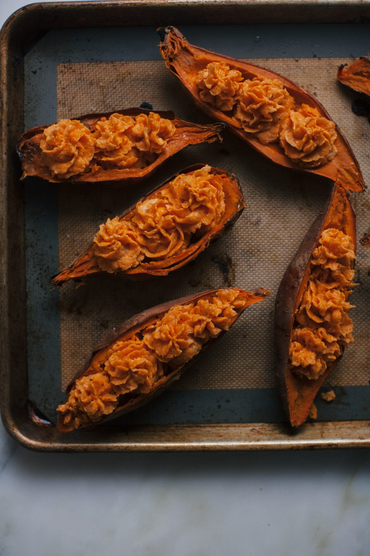 Double Baked Sweet Potato with Caramelized Onions + Comté + Rosemary Butter