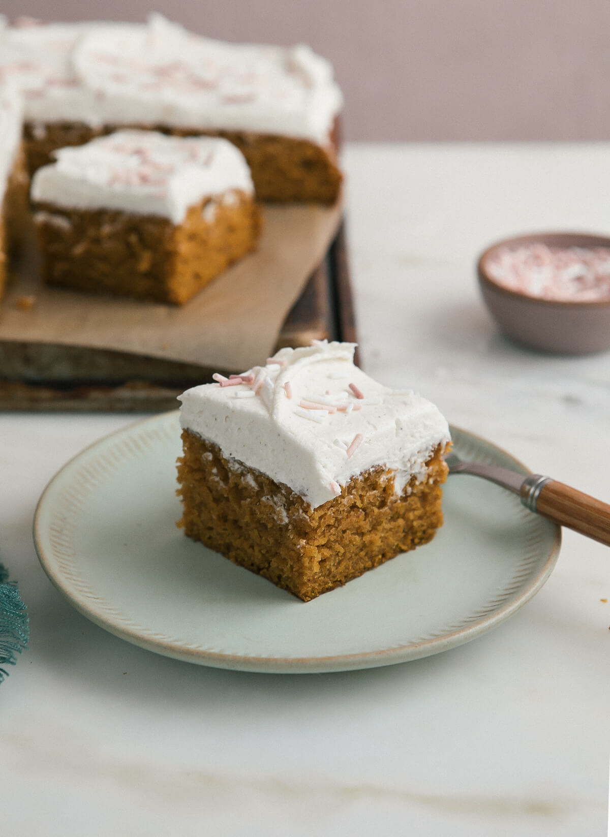 Slice of Pumpkin Sheet Cake with Brown Butter Frosting