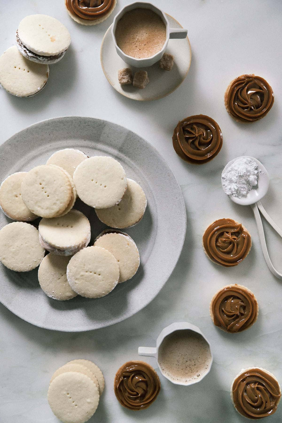 alfajores on a kitchen counter with coffee
