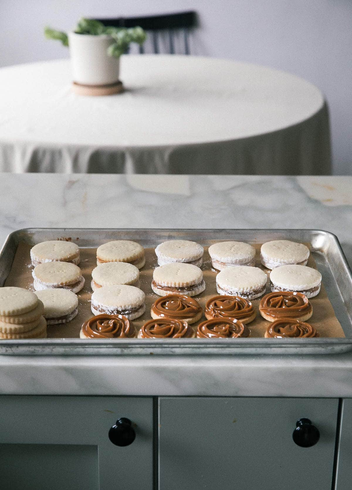 alfajores on baking sheet