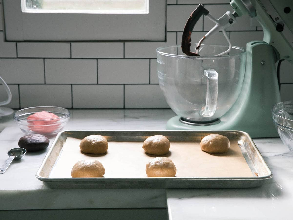 Concha dough formed into balls for their second rise
