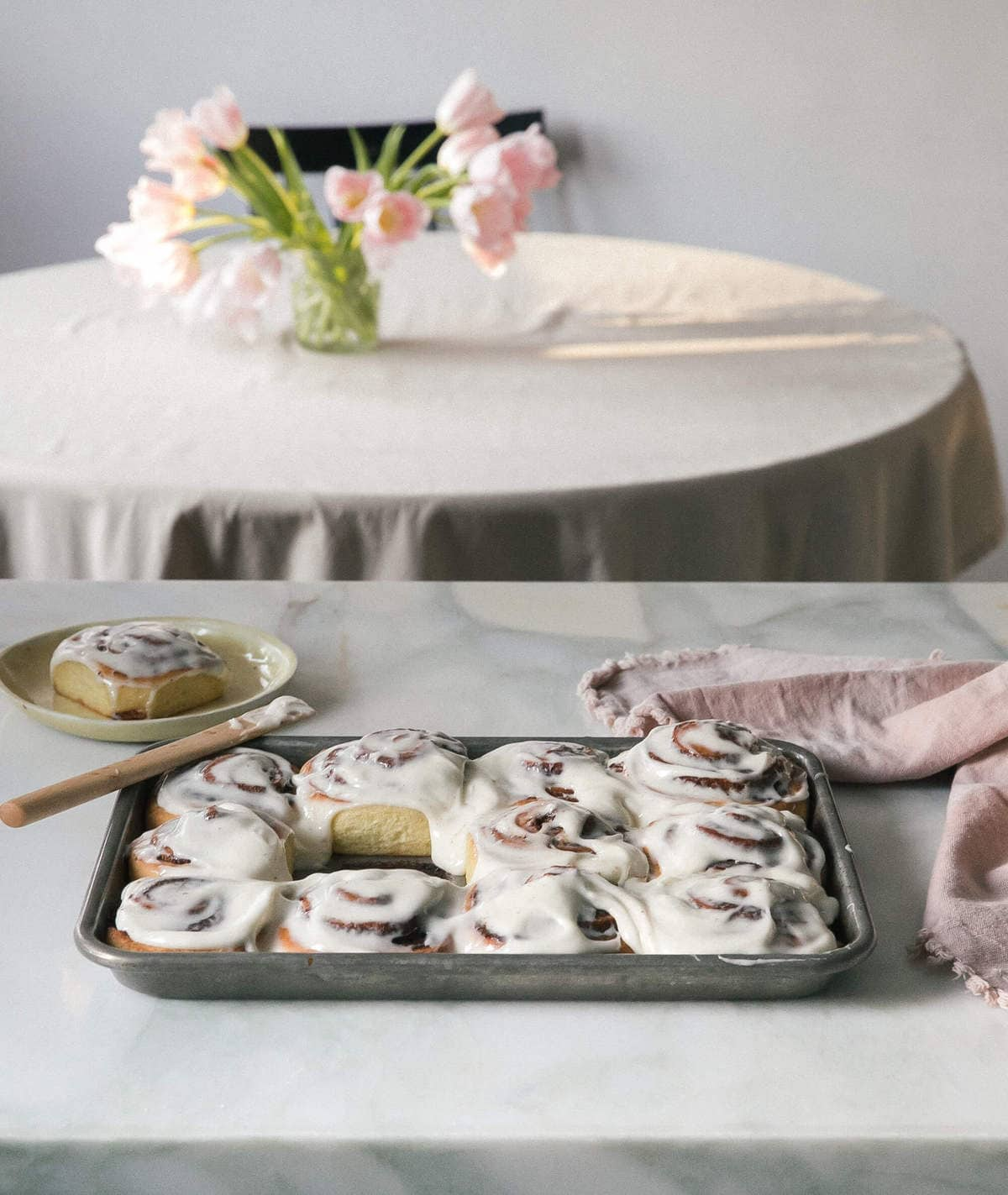 warm cinnamon rolls with frosting with center roll removed
