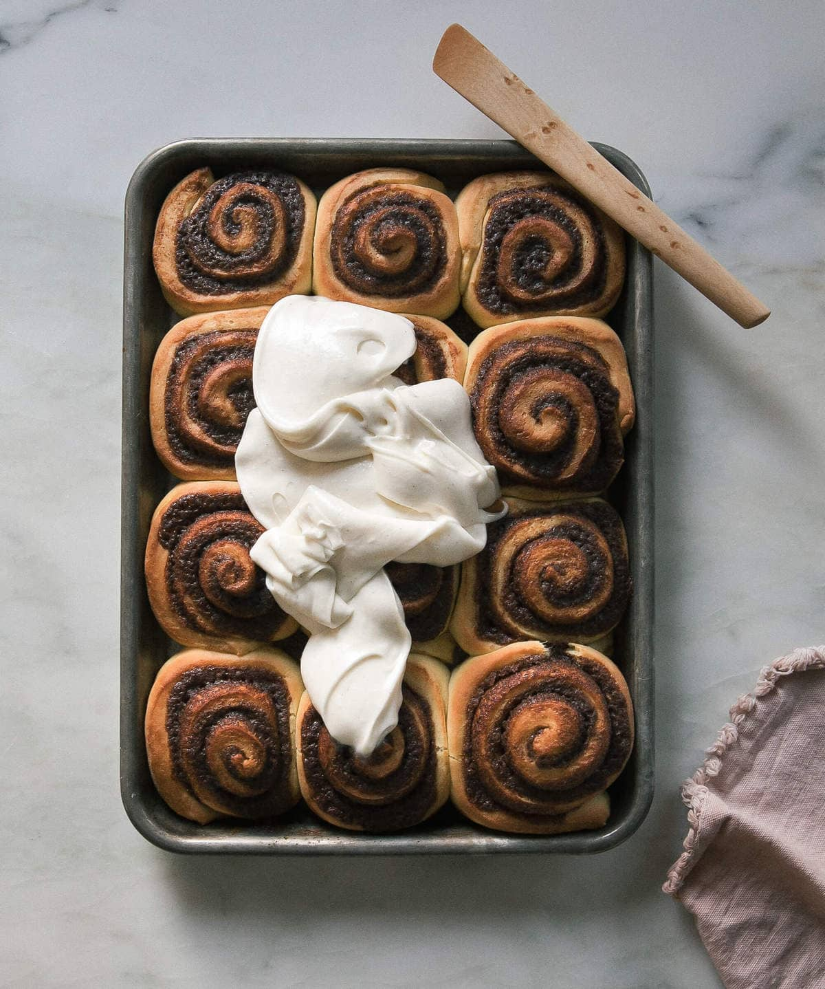 warm cinnamon rolls with frosting poured on top