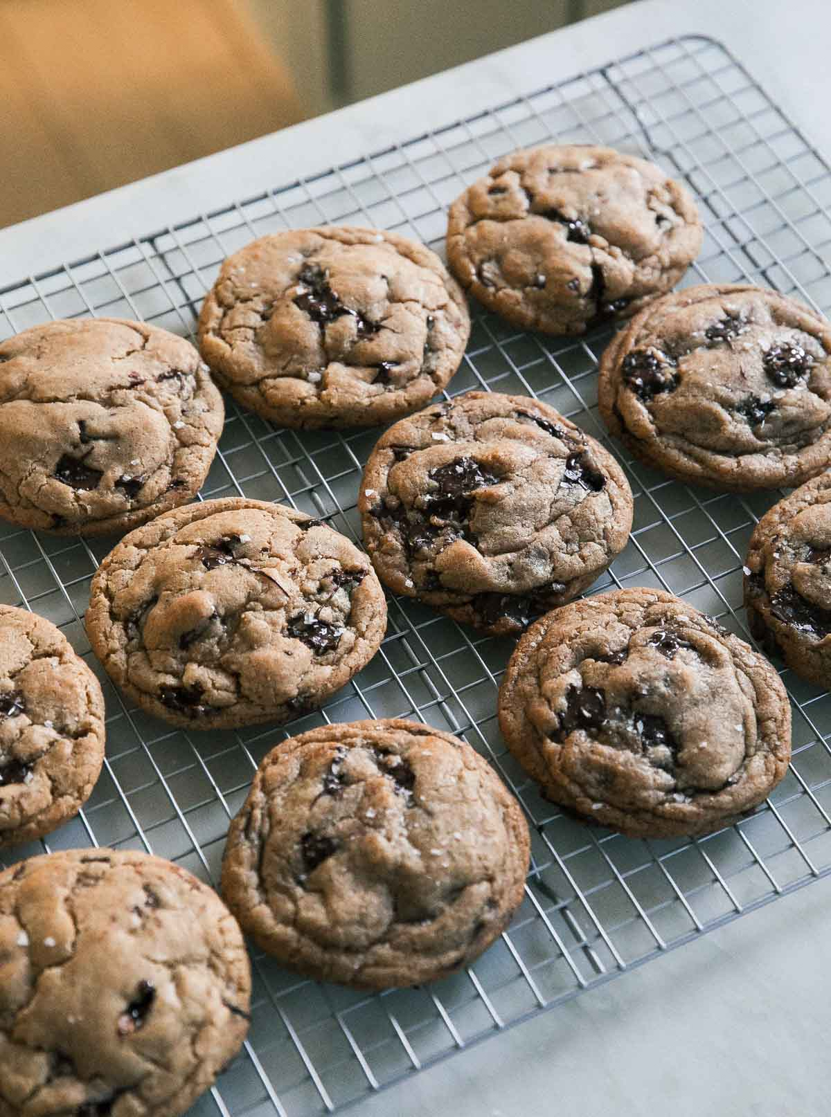 angle of chocolate chip cookies on a cooling rack