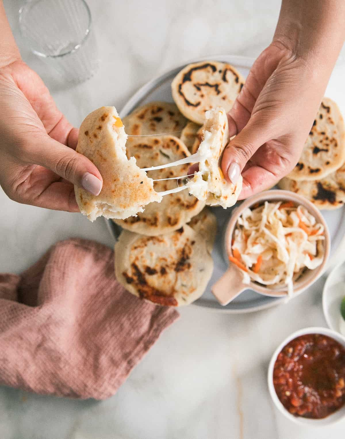Pupusa being torn apart with cheese pull