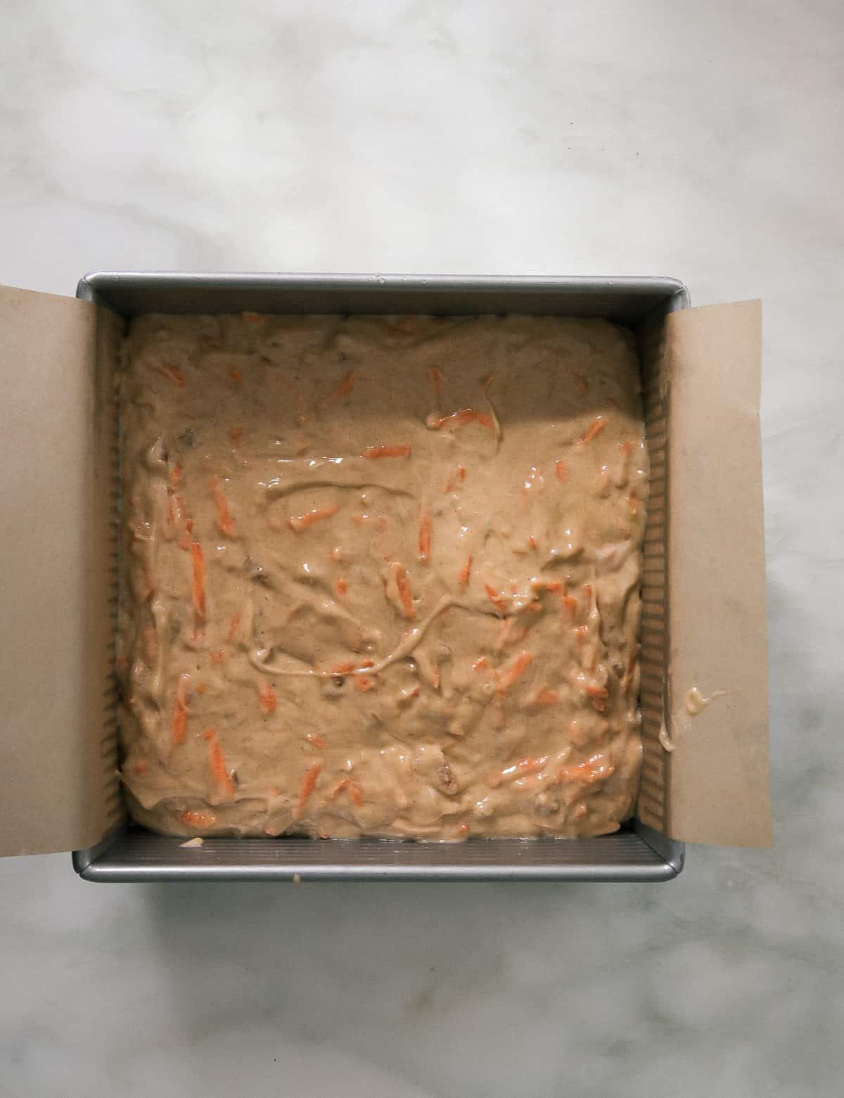 Carrot cake batter in baking pan