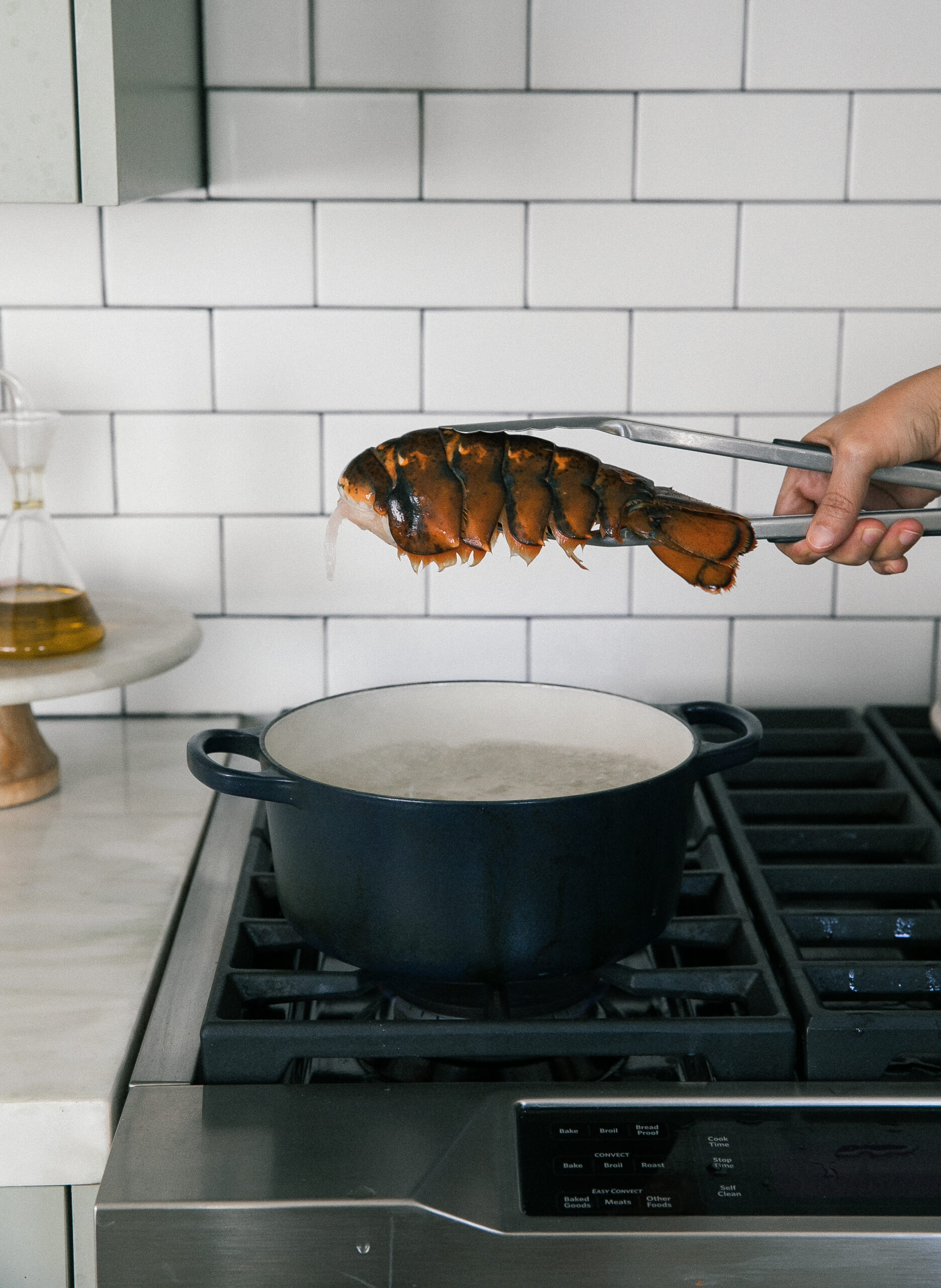 Lobster Tail being lowered in water