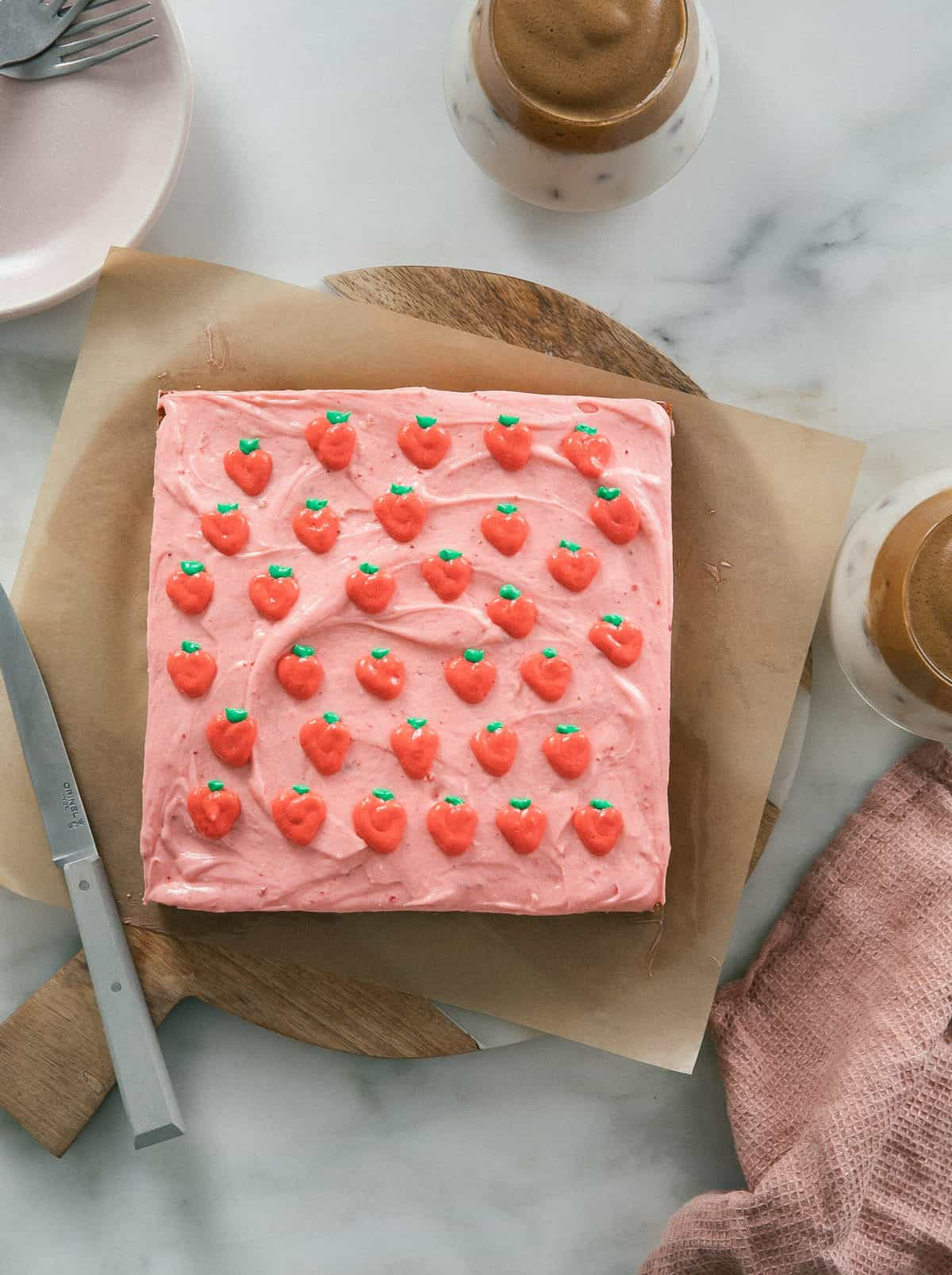 square strawberry cake with strawberries on top