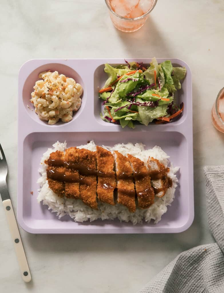 Overhead pork katsu on plate with mac salad and salad