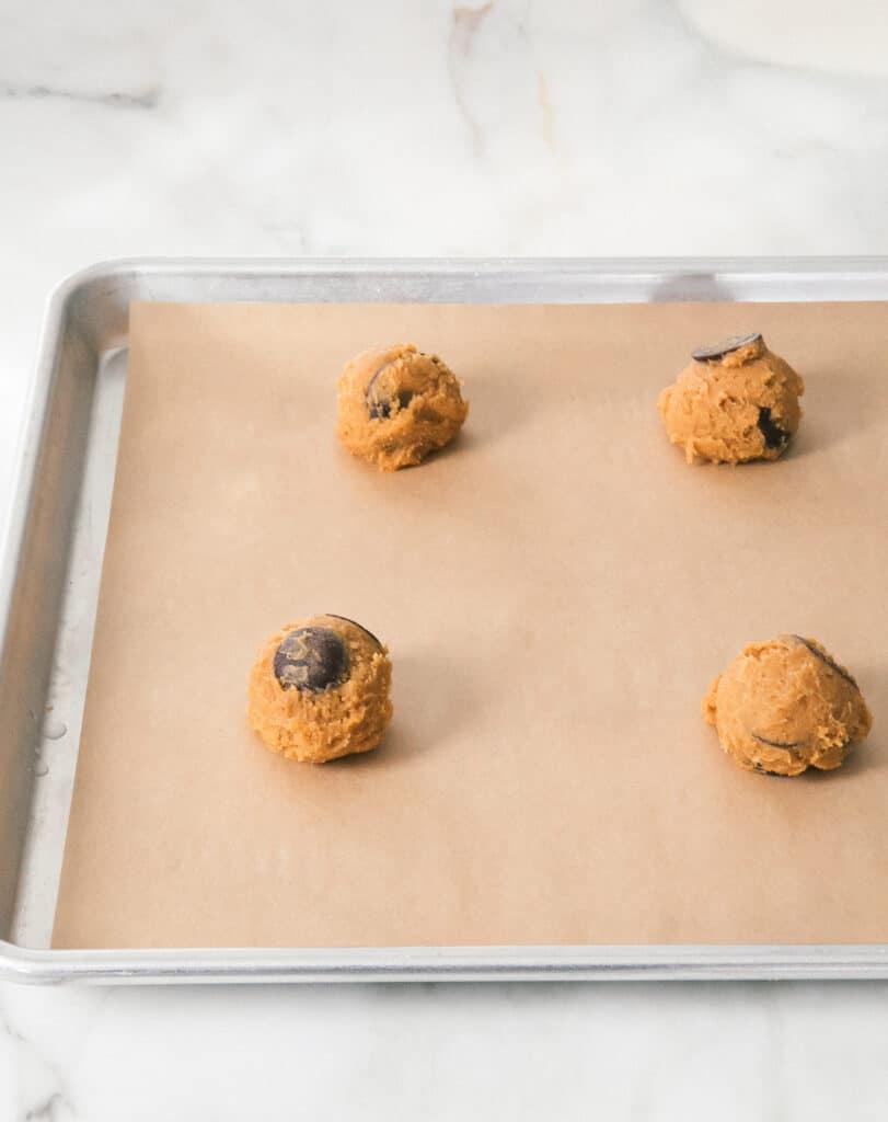 Pumpkin Chocolate Chip Cookies dough on a baking sheet