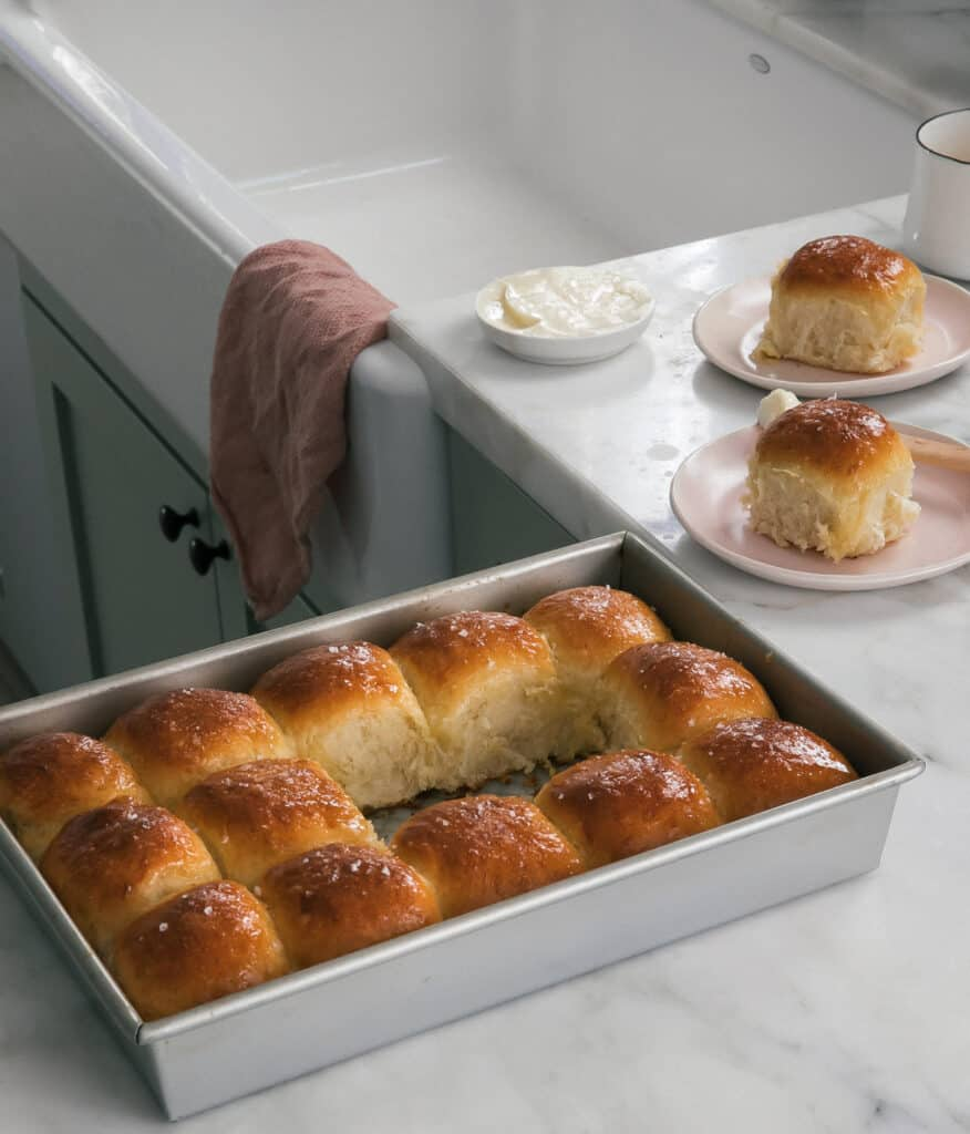 Salted Honey Parker House Rolls on counter