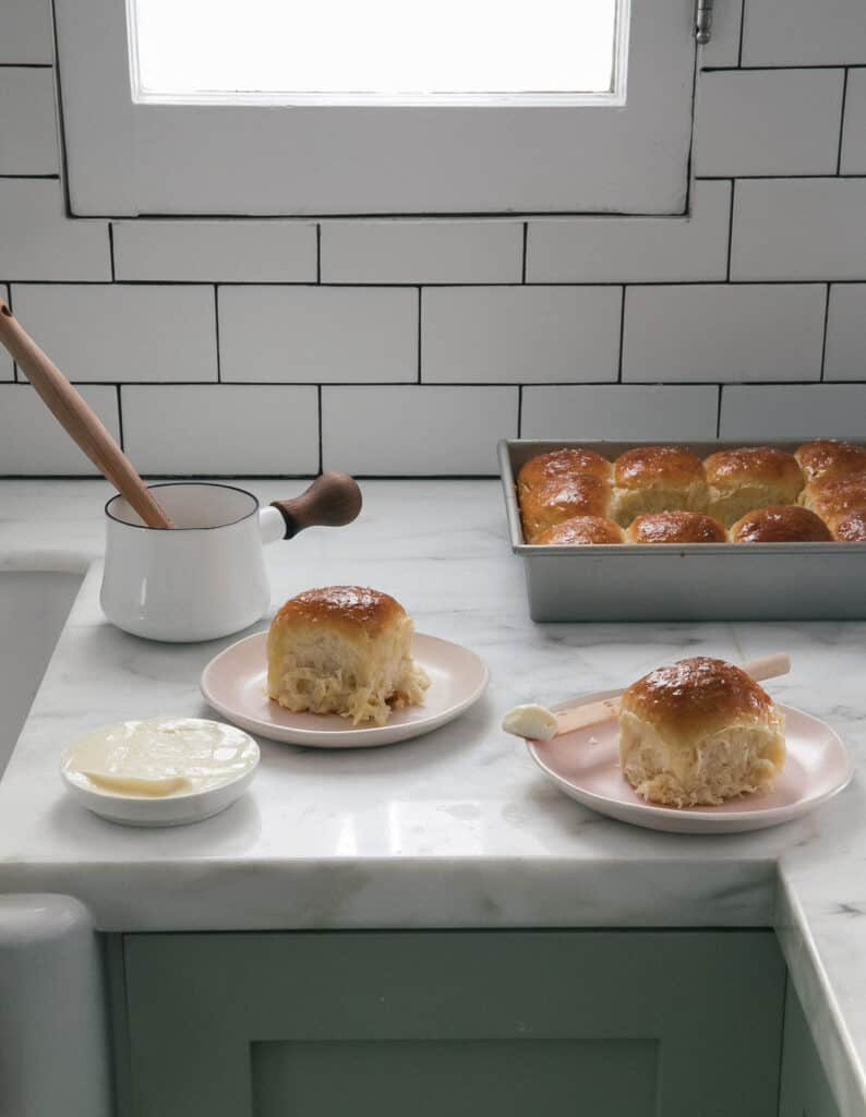 Salted Honey Parker House Rolls plated