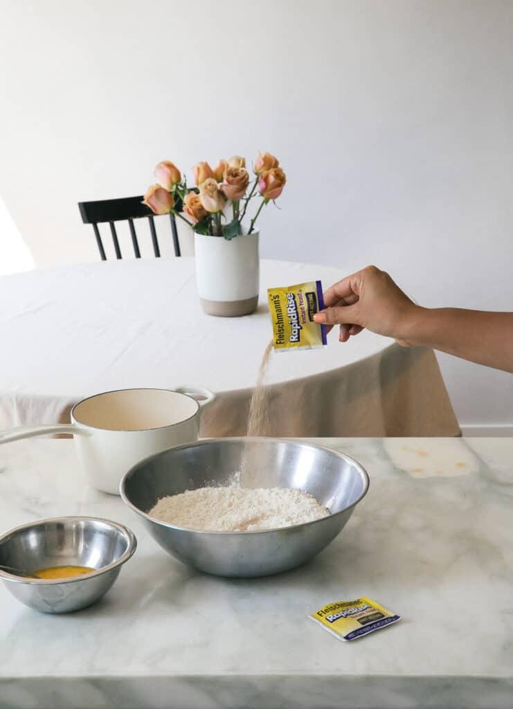 Instant yeast into flour mixture