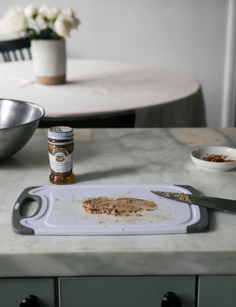 Anchovy garlic paste on cutting board